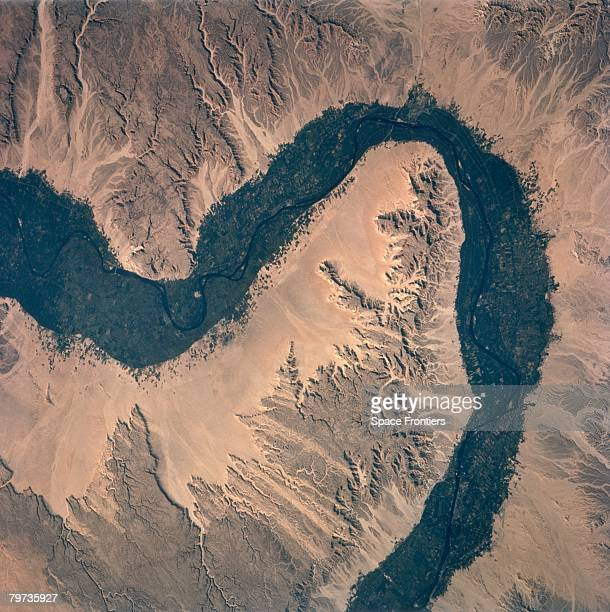The River Nile in Egypt with the city of Qena at the top right, as seen from the space shuttle Columbia during NASA's STS-75 mission, 1996.