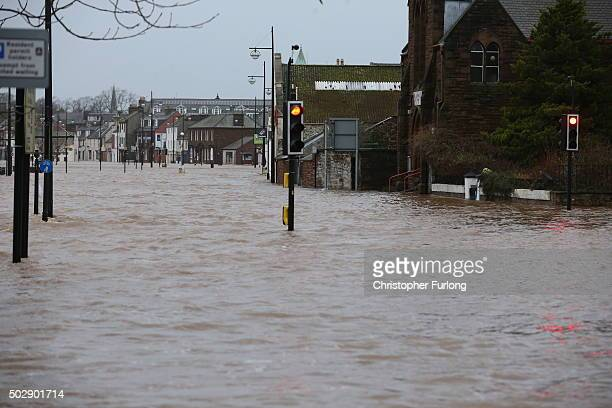 The River Nith bursts its banks on December 30 2015 in Dumfries Scotland Severe flooding has affected large parts of northern England with homes and...