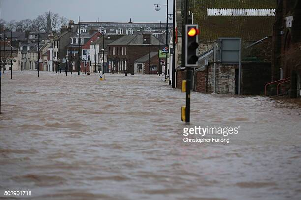 The River Nith bursts its banks on December 30, 2015 in Dumfries, Scotland. Severe flooding has affected large parts of northern England, with homes...