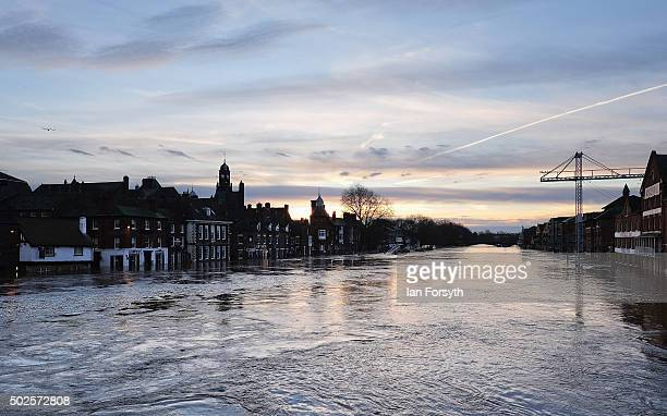 The River Ouse in York floods riverside business premises after heavy rain caused severe flooding in the city on December 27 2015 in York England...