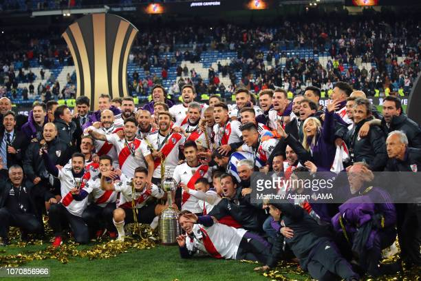 The River Plate players and staff celebrate with the trophy at the end of the second leg of the final match of Copa CONMEBOL Libertadores 2018...
