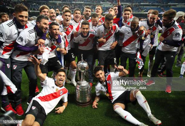The River Plate players celebrate with the trophy at the end of the second leg of the final match of Copa CONMEBOL Libertadores 2018 between Boca...