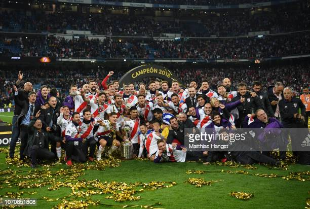 The River Plate team celebrate with the Copa Libertadores Trophy following their victory in the second leg of the final match of Copa CONMEBOL...