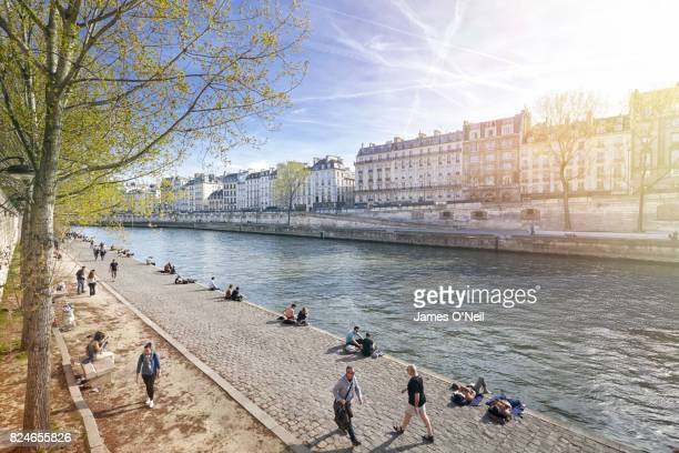 The River Seine walkway with Parisians relaxing, Paris, France