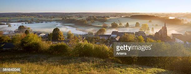 The river Semois and the village Chassepierre covered in morning mist Belgian Ardennes Belgium