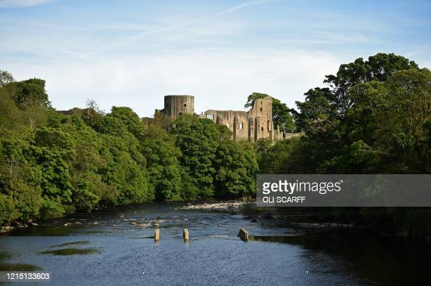 The River Tees is pictured at Barnard Castle less than 30 miles southwest of Durham north east England on May 25 a popular tourist village that...