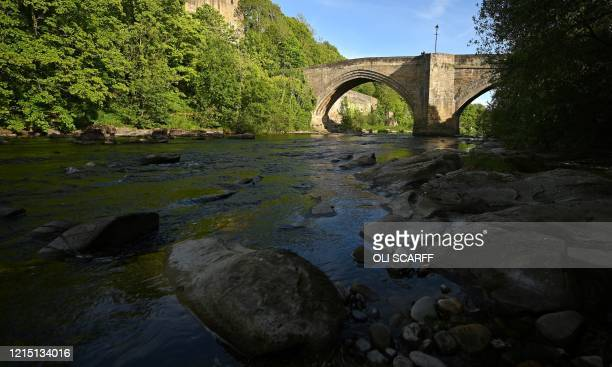 The River Tees is pictured at Barnard Castle, less than 30 miles southwest of Durham, north east England, on May 25 a popular tourist village that...