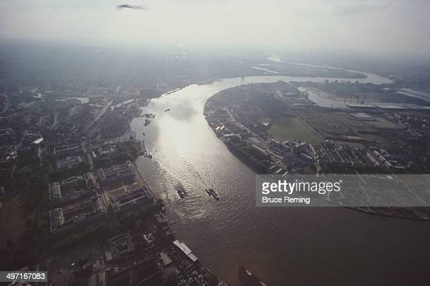 The River Thames in southeast London UK with the Old Royal Naval College on the left and the Isle of Dogs on the right circa 1980