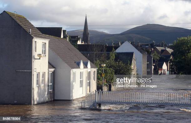 The river Tweed bursts its banks in the centre of Peebles Scottish Borders as rain causes misery for many across the UK
