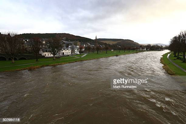 The river Tweed still very swollen with flood water from Storm Frank a day after it burst it's banks flooding the area on December 31 2015 in Peebles...