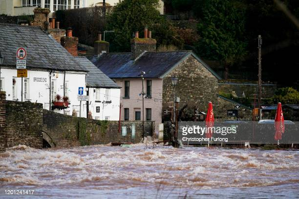 The river Usk bursts its banks at Crickhowell bridge near the Bridge End Inn on February 16, 2020 in Crickhowell, Wales. The Met Office have issued a...
