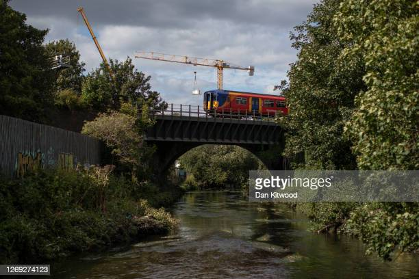 The river Wandle runs under a railway line in Wandsworth on August 26, 2020 in London, England. The river Wandle is a tributary of the river Thames...