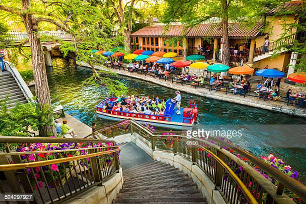 the riverwalk, san antonio park walkway scenic canal tour boat - san antonio stock photos and pictures