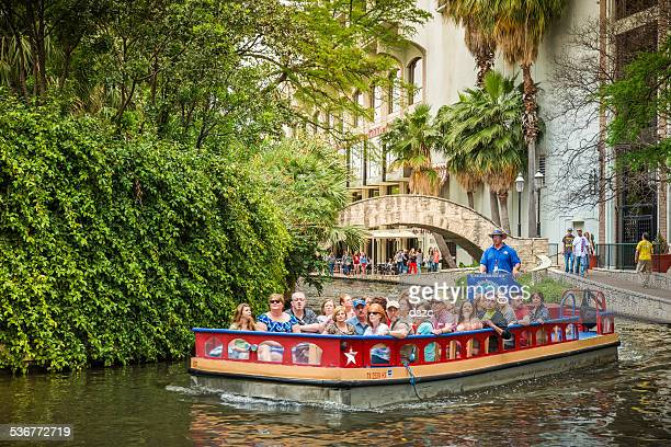 the riverwalk, san antonio park walkway scenic canal tour boat - san antonio river walk stock photos and pictures