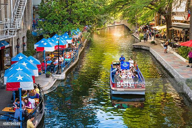 the riverwalk, san antonio texas,  park walkway along scenic canal - san antonio stock photos and pictures