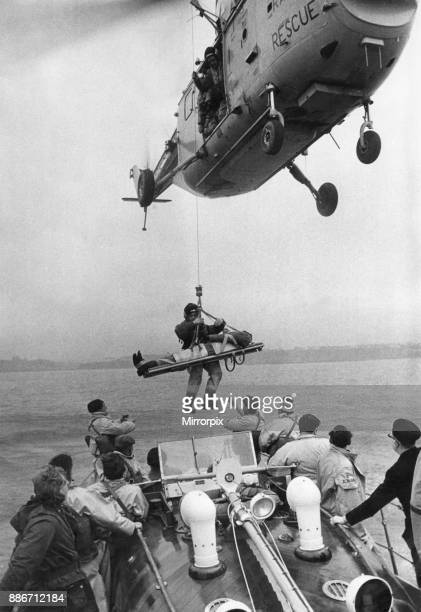 The RNLI and RAF Air Sea Rescue service seen here testing a new type of stretcher off the coast of Whitby The lifeboat from Whitby and a 202 Squadron...