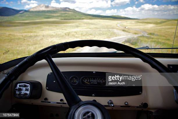 the road ahead - vehicle interior stock pictures, royalty-free photos & images