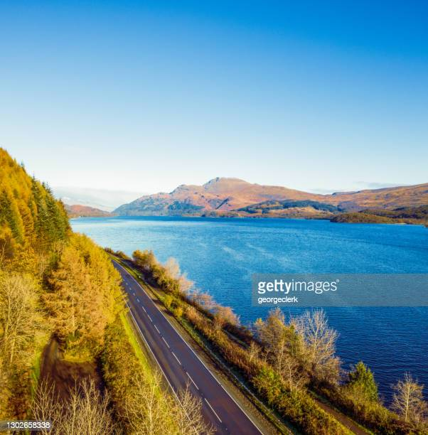 the road along loch lomond - road stock pictures, royalty-free photos & images