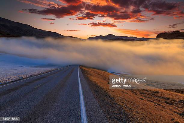 The road in the fog at sunset. Norway