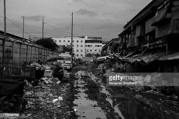 The road into a dumpsite at Tondo, Manilla in the Philippines. This dumpsite is the home to hundreds of families who work and live here amongst...