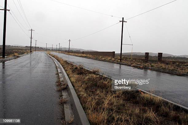 The road leading to SunCal Cos' Ritter Ranch stalled development stands in Palmdale California US on Saturday Feb 19 2011 Beginning in June 2008...