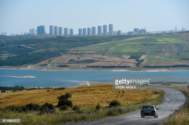 The road that overlooks the Sazlodere dam is pictured on June 12 at the small coastal village of Karaburun, near Istanbul. - Karaburun's residents...
