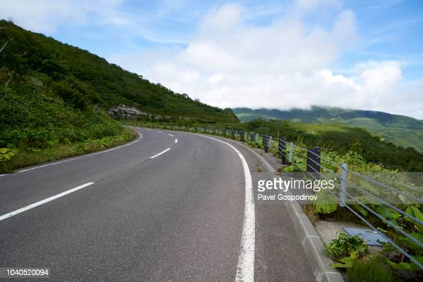 the road through shiretoko pass to utoro, hokkaido, japan - mountain pass stock pictures, royalty-free photos & images
