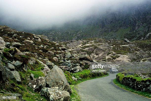 The road to Dingle via the Connor Pass a narrow winding road through rocky glaciated mountains