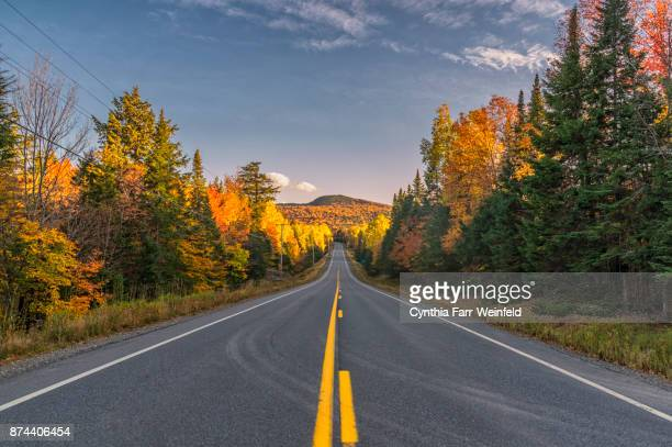 the road to greenville maine - maine stock pictures, royalty-free photos & images