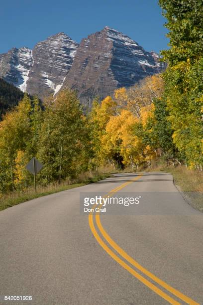 the road to maroon bells in colorado - white river national forest stock photos and pictures