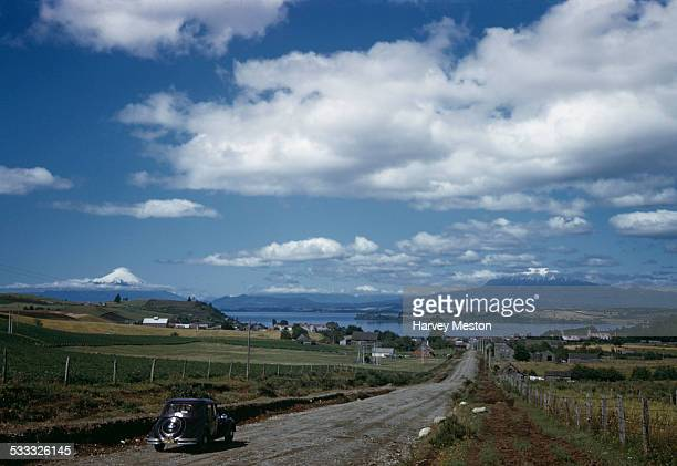 The road to Puerto Varas on the shores of Llanquihue Lake in Chile South America circa 1965 Osorno Volcano is visible in the background left