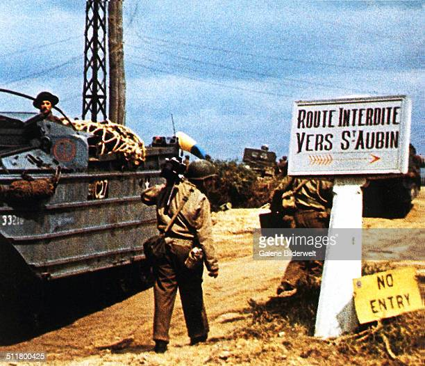 The road to Saint-Aubin-sur Mer has been closed due to fighting in the area. June 1944. Without much success the German Army was trying to prevent...
