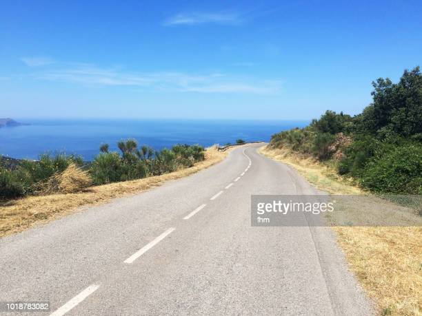 the road to the sea - southern europe stock pictures, royalty-free photos & images