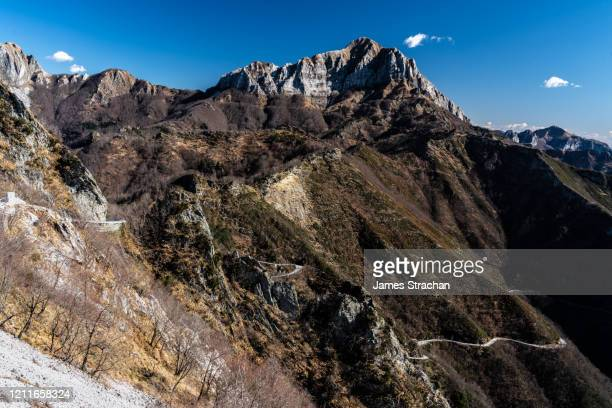 the road up to cervaiole marble quarry on mount altissimo, seravezza, owned by henraux, tuscany, italy (property release) - james strachan stock pictures, royalty-free photos & images