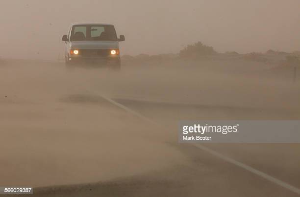 The roadway along old highway 136 heading to Keeler, California is obscured by drifting dust from the sandunes next to Owens Lake during a dust storm...