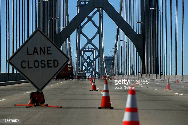 The roadway of the western span of the San Francisco Oakland Bay Bridge is seen empty as workers perform maintenance before the opening of the new...