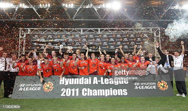 The Roar celebrate victory after the ALeague Grand Final match between the Brisbane Roar and the Central Coast Mariners at Suncorp Stadium on March...