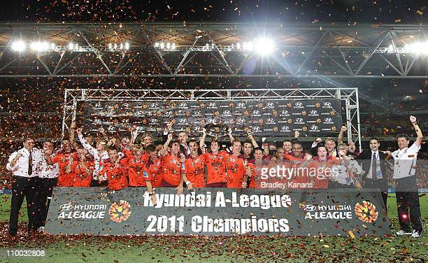 The Roar celebrate victory after the A-League Grand Final match between the Brisbane Roar and the Central Coast Mariners at Suncorp Stadium on March...