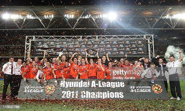 The Roar celebrate victory during the A-League Grand Final match between the Brisbane Roar and the Central Coast Mariners at Suncorp Stadium on March...