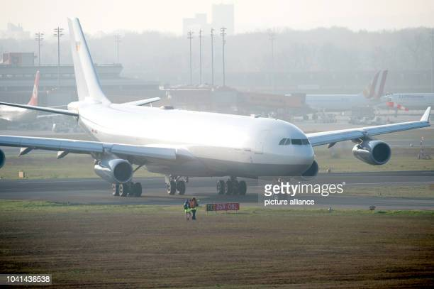 The 'Robert Koch' evacuation plane lands at Tegel Airport in Berlin Germany 27 November 2014 The Airbus A340 has an isolation unit for highly...