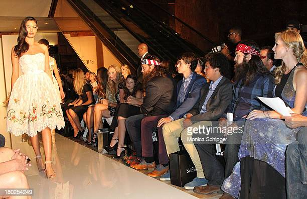 The Robertson family of Duck Dynasty attend an Evening By Sherri Hill fashion show during MercedesBenz Fashion Week Spring 2014 at Trump Tower on...