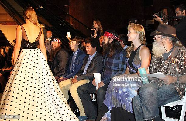 The Robertson family of Duck Dynasty watch Sadie Robertson walk in the Evening By Sherri Hill fashion show during MercedesBenz Fashion Week Spring...