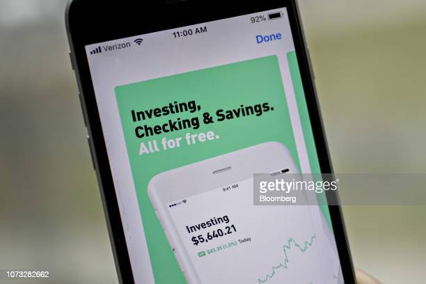 The Robinhood application is displayed in the App Store on an Apple Inc iPhone in an arranged photograph taken in Washington DC US on Friday Dec 14...