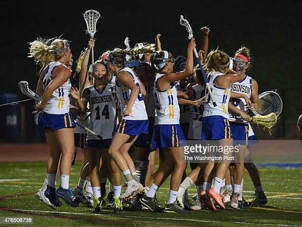 The Robinson Rams celebrate their 1513 overtime victory over Centreville in the Virginia 6A girls' lacrosse state semifinal on June 9 2015 in Fairfax...