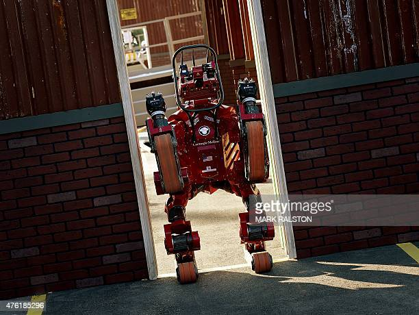 The robot 'CHIMP' developed by Team Tartan Rescue from the US passes through a doorway during the finals of the DARPA Robotics Challenge at the...