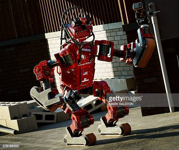 The robot 'CHIMP' developed by Team Tartan Rescue from the US prepares to complete a task during the finals of the DARPA Robotics Challenge at the...