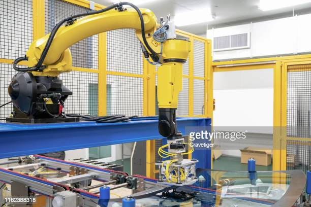 the robot for metal handing sensor eye sight in forming process .modern factory for industrial manufacturing process. heavy automation robot arm machine in smart factory industrial with vision sensor system application. industry 4th iot concept. - deep learning stock photos and pictures