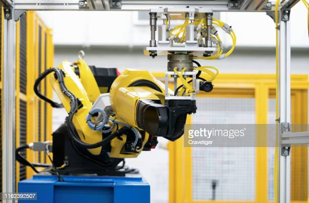 the robot for metal handing sensor eye sight in forming process .modern factory for industrial manufacturing process. - deep learning stock photos and pictures