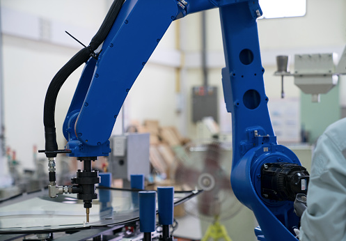 The robot for metal handing sheet metal in forming process .Modern factory for industrial manufacturing process. - gettyimageskorea