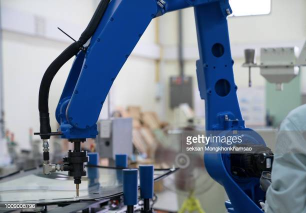 the robot for metal handing sheet metal in forming process .modern factory for industrial manufacturing process. - industrial revolution bildbanksfoton och bilder